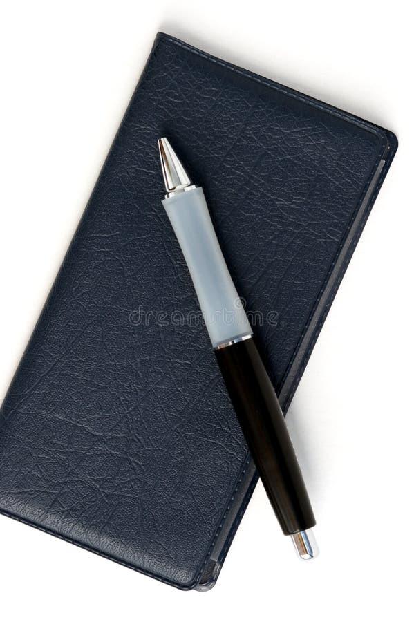 Carnet di assegni e penna immagini stock libere da diritti