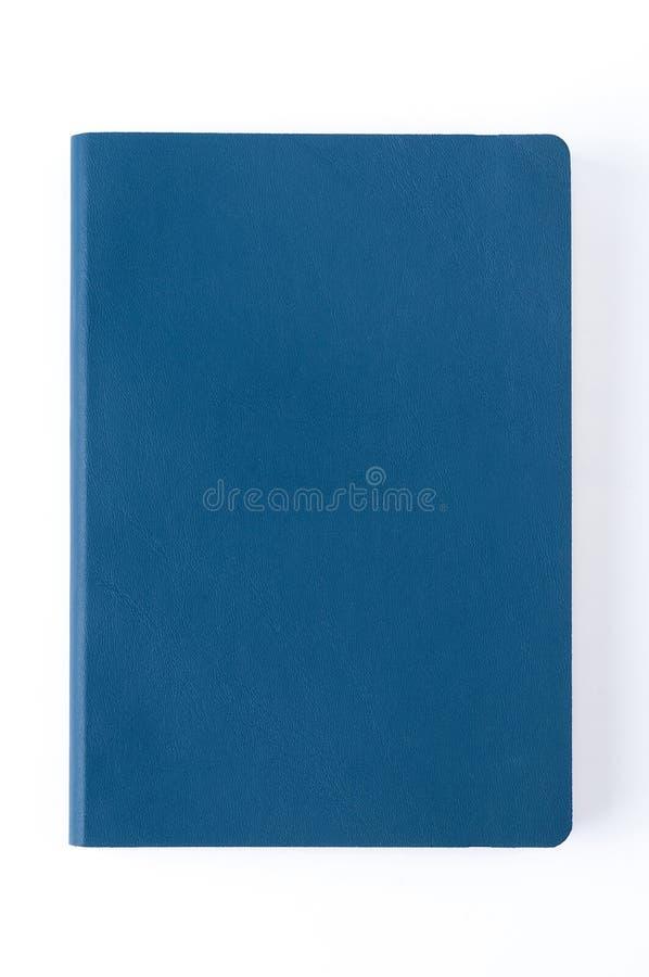 Carnet en cuir bleu d'isolement sur le fond blanc photos libres de droits
