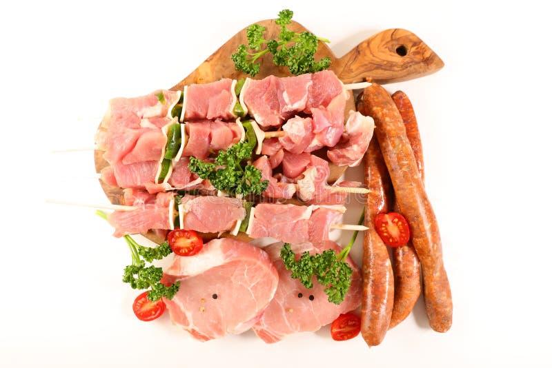 Carni crude per il barbecue isolato fotografie stock