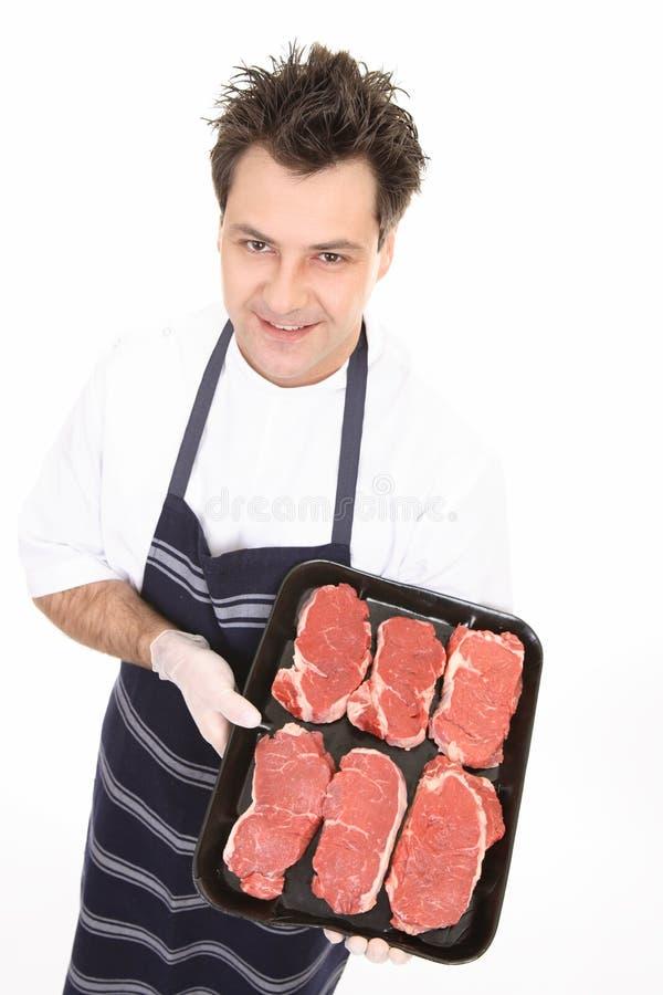 Carniceiro com bife macio fotos de stock royalty free