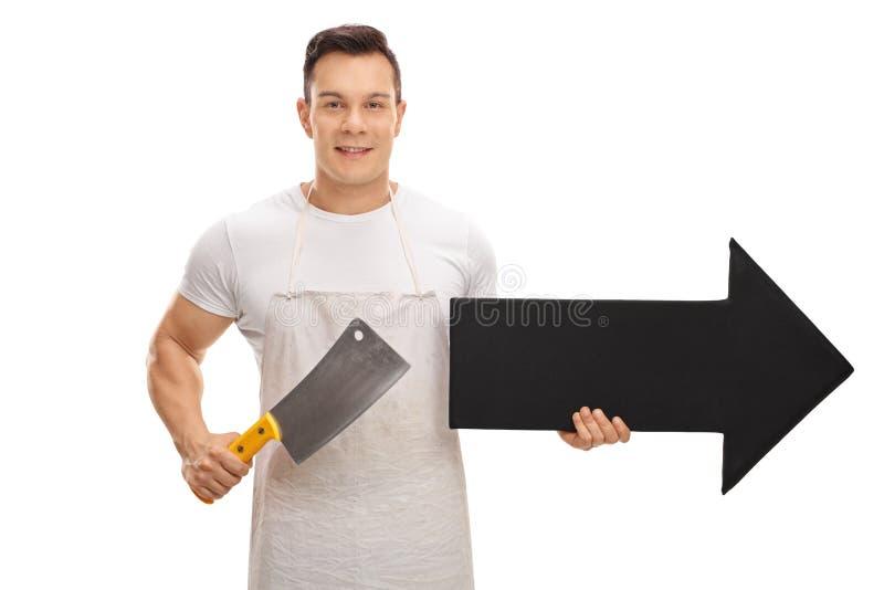Carnicero que sostiene una cuchilla y una flecha fotografía de archivo libre de regalías