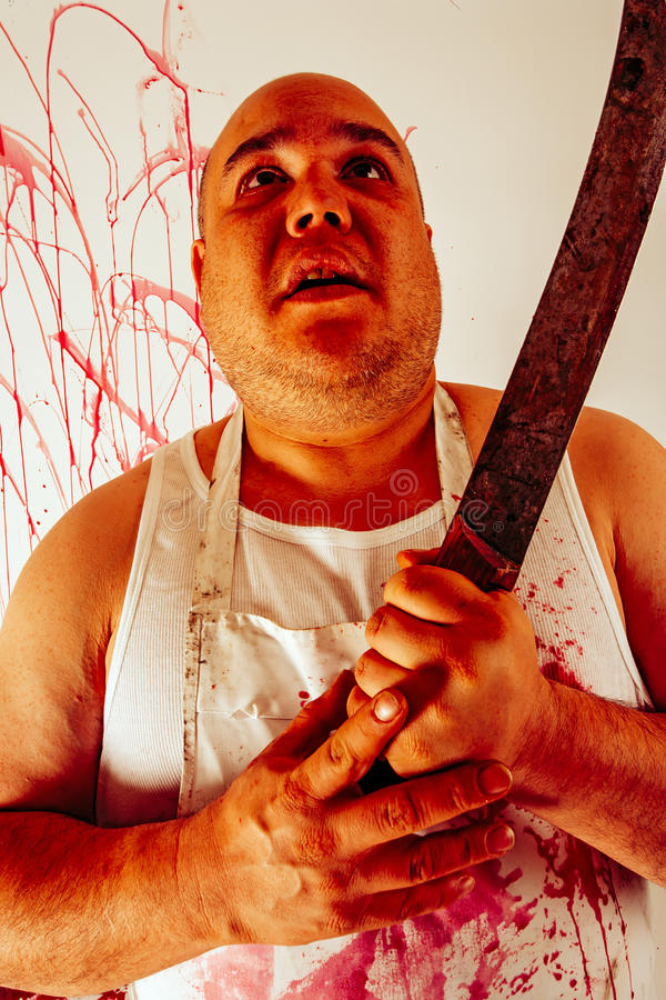 Carnicero sangriento insano imagenes de archivo