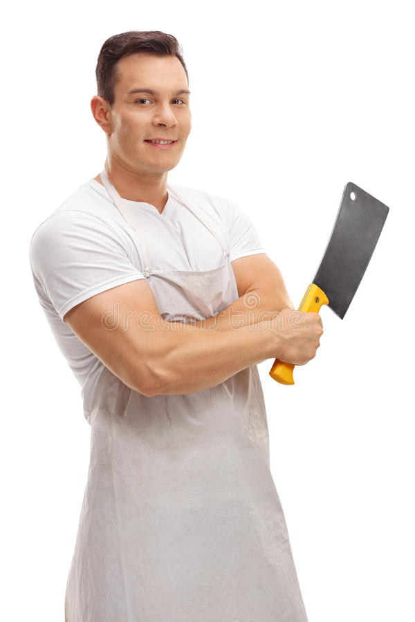 Carnicero sonriente que presenta con una cuchilla fotos de archivo