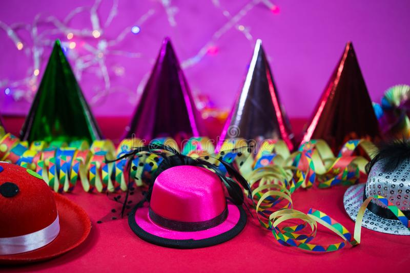 Carnival, background with party hats and streamers stock photo