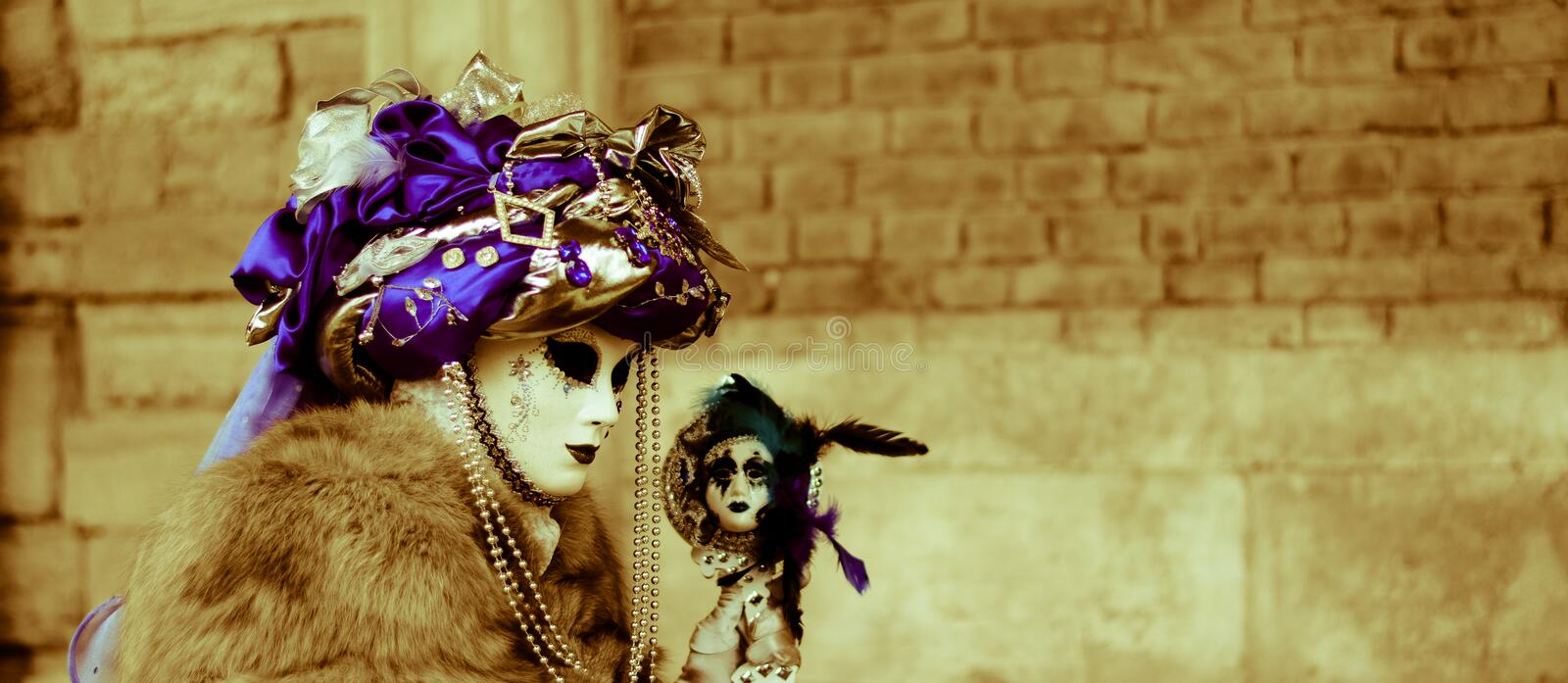The witch with the head of the doll. Carnival begins with fantastic masks with colorful costumes stock photography