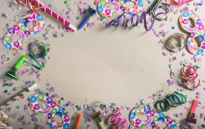 Carnival or birthday party. Confetti and serpentines on pastel grey background royalty free stock photos