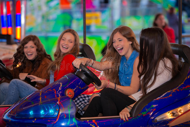 Carnival bumper ride group of teens royalty free stock images