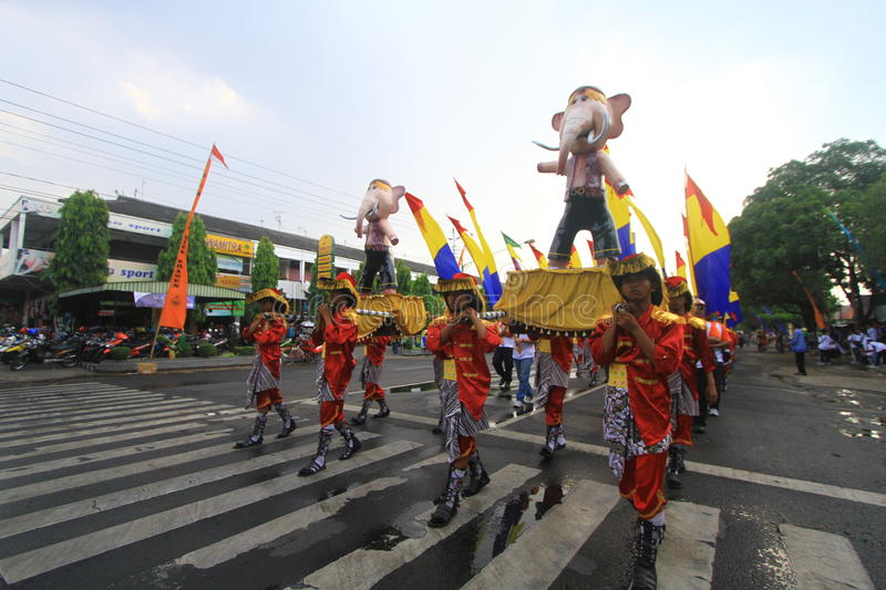 Carnival city anniversary Sragen. A number of soldiers lined up regularly with the mascot Ganesha as Kota Sragen Anniversary logo, Java, Indonesia. Each year stock images