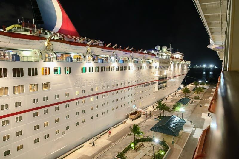 Carnival Cruise Ship at Night. Carnival cruise ship docked at night in Nassau, Bahamas royalty free stock photo