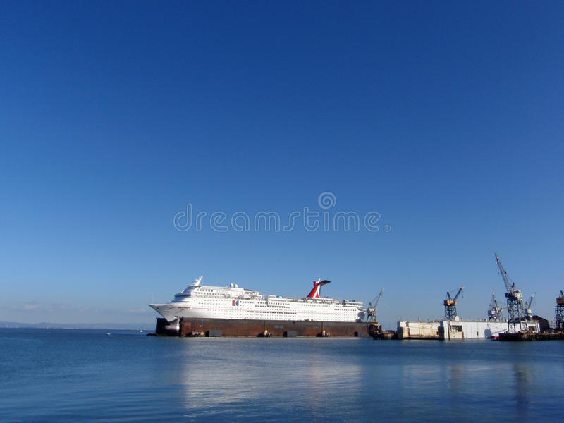Carnival Cruise ship sits in Dry Dock as it receives repairs and royalty free stock photo
