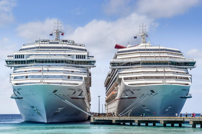 Grand Turk, Turks and Caicos - April 03 2014: Carnival Liberty and Carnival Victory cruise ships docked in the Grand Turk Cruise P royalty free stock photo