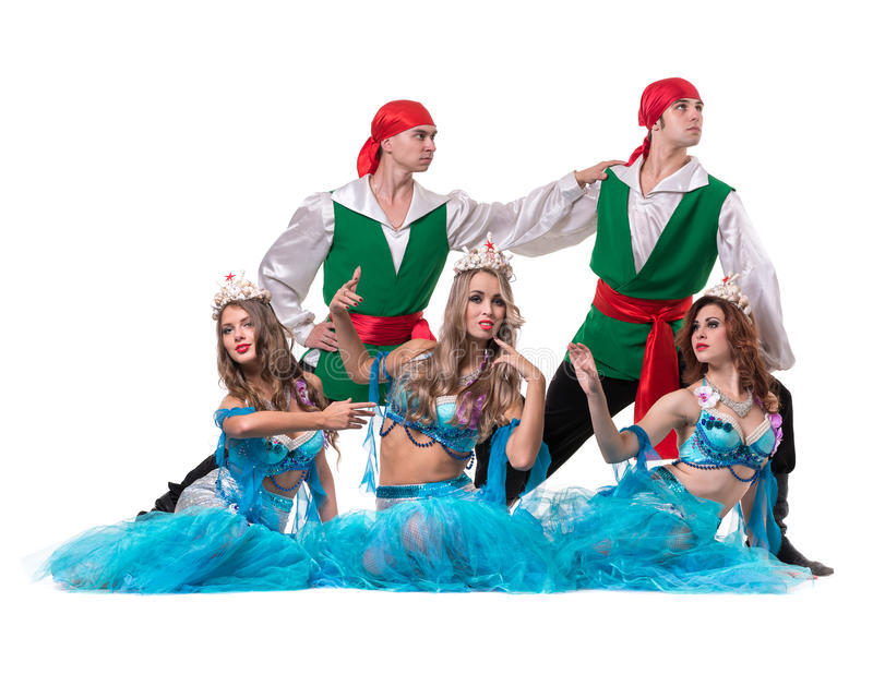 Carnival dancer team dressed as mermaids and pirates. Isolated on white background in full length. Carnival dancer team dressed as mermaids and pirates. Retro stock image