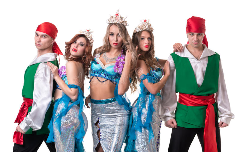 Carnival dancer team dressed as mermaids and pirates. Isolated on white background in full length. Carnival dancer team dressed as mermaids and pirates. Retro royalty free stock images