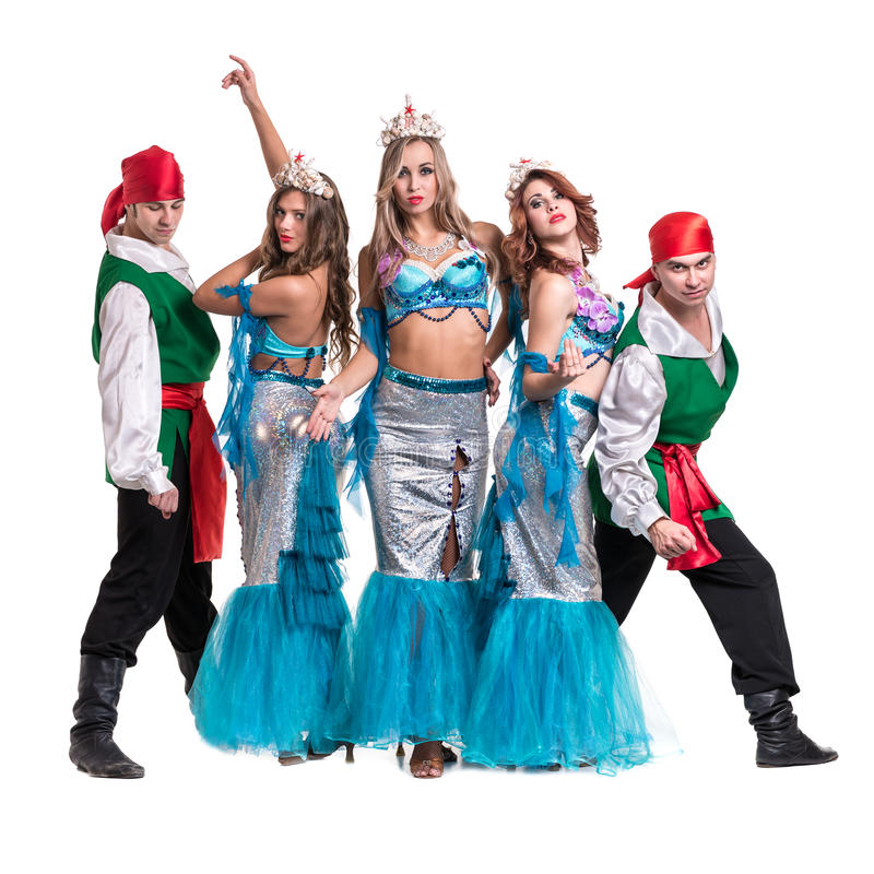 Carnival dancer team dressed as mermaids and pirates. Isolated on white background in full length. Carnival dancer team dressed as mermaids and pirates. Retro royalty free stock photo