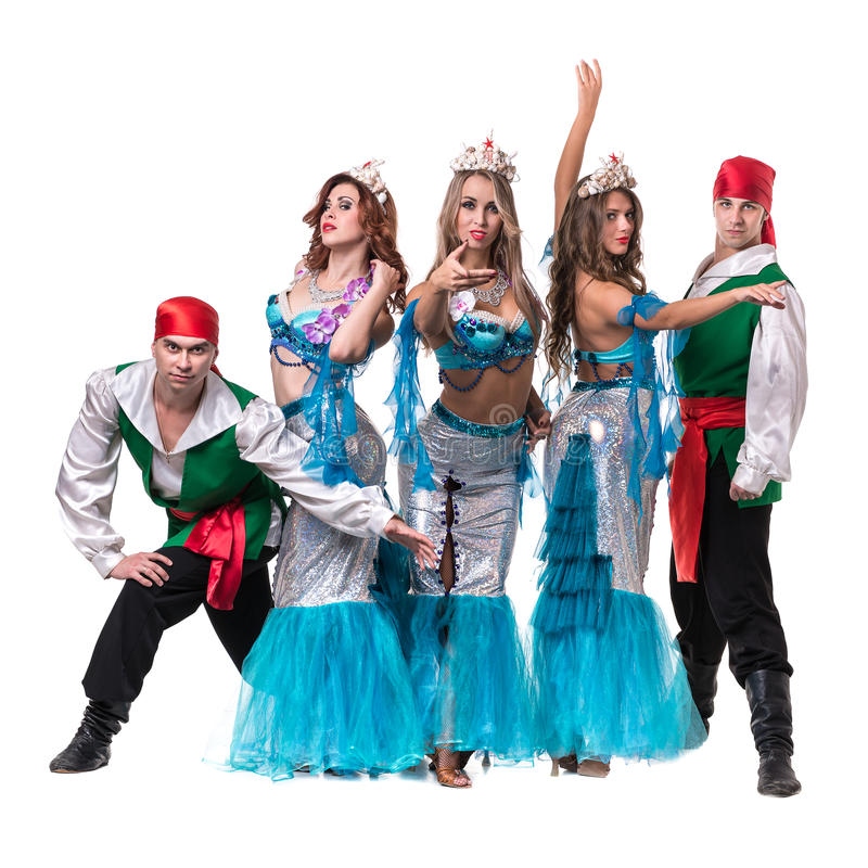 Carnival dancer team dressed as mermaids and pirates. Isolated on white background in full length. Carnival dancer team dressed as mermaids and pirates. Retro stock photography