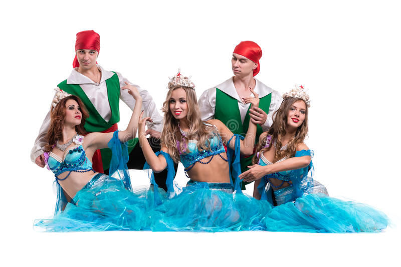 Carnival dancer team dressed as mermaids and pirates. Isolated on white background in full length. Carnival dancer team dressed as mermaids and pirates. Retro royalty free stock photography