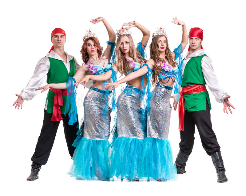 Carnival dancer team dressed as mermaids and pirates. Isolated on white background in full length. Carnival dancer team dressed as mermaids and pirates. Retro royalty free stock photos