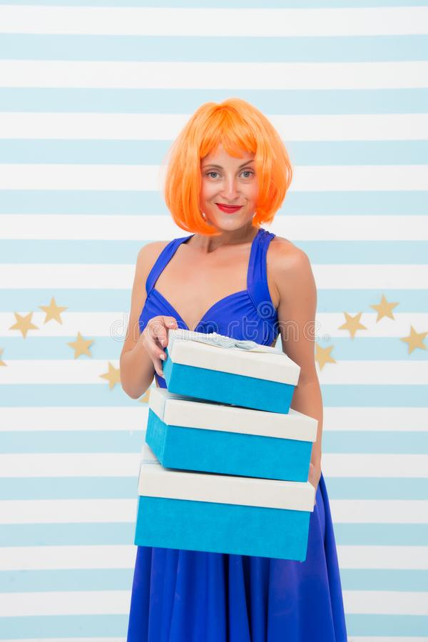 Carnival and holidays season. Woman red ginger wig blue dress hold pile gift boxes. Birthday gift. Lady bright outfit. Ready to celebrate. Festive mood concept stock photography