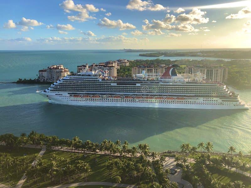 Carnival Cruise Line ship leaving Miami. Carnival Horizon cruise ship leaving Port of Miami, Florida, USA royalty free stock image