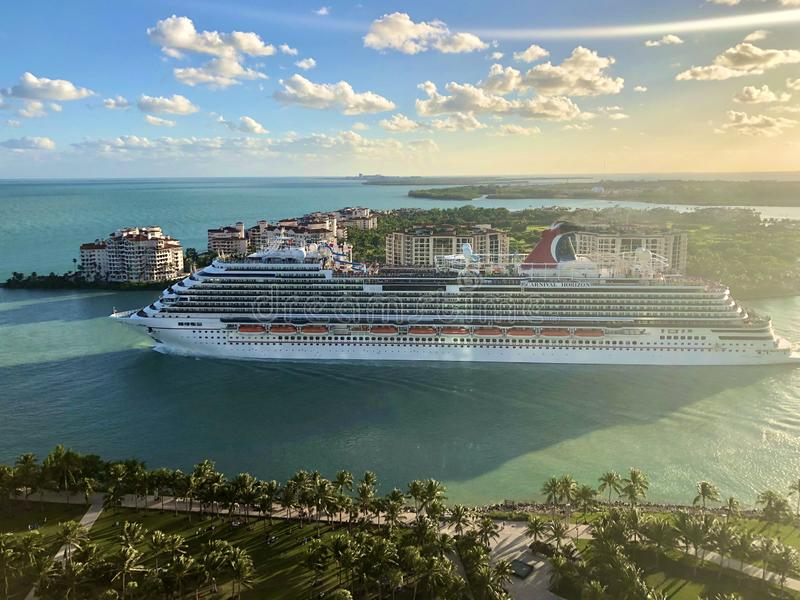 Carnival Cruise Line ship leaving Miami. Carnival Horizon cruise ship leaving Port of Miami, passing near the Fishers Island, Florida, USA royalty free stock photos