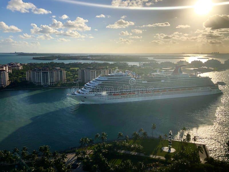 Carnival Cruise Line ship leaving Miami. Carnival Horizon cruise ship leaving Port of Miami, passing near the Fishers Island, Florida, USA stock photo