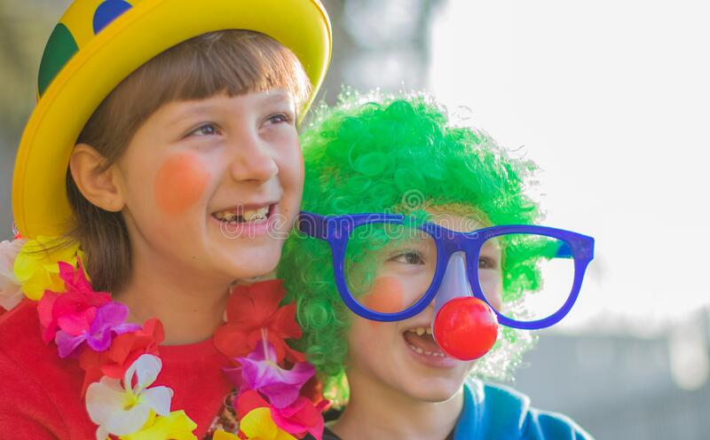 carnival kids smiling and playing outdoor stock images