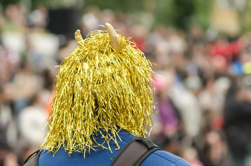 Carnival. Man with wig and horn of devil. A devil mask shot from the back of a man stock images