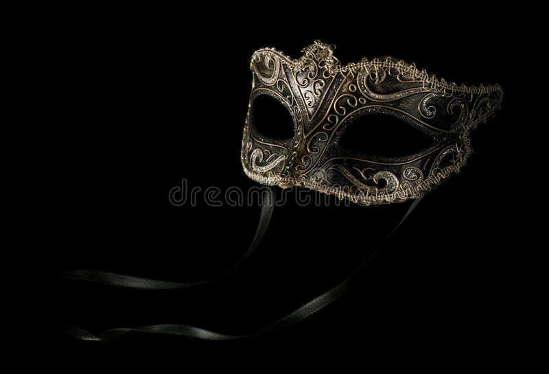 Carnival mask on black with ribbon stock image