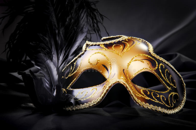 Carnival mask on black silk background stock images