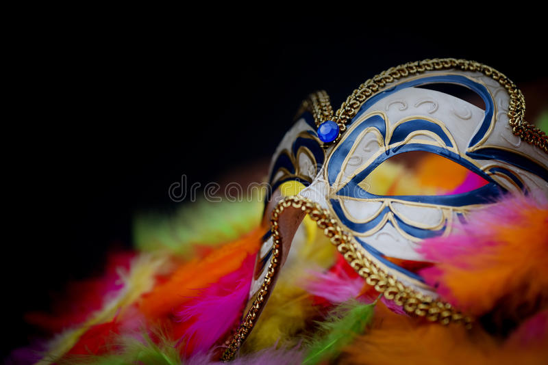 Carnival mask. On color feathers stock image