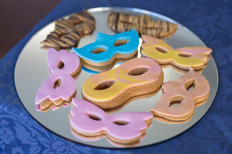 Carnival Mask Cookies Covered with Coloured icing.  stock photography