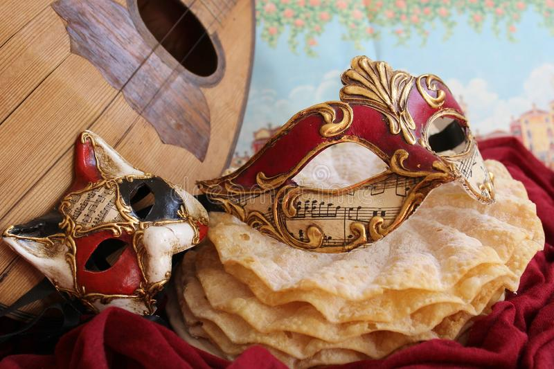 Carnival mask and a mandolin. Carnival mask and a mask of cat, some pancakes and a mandolin stock photos