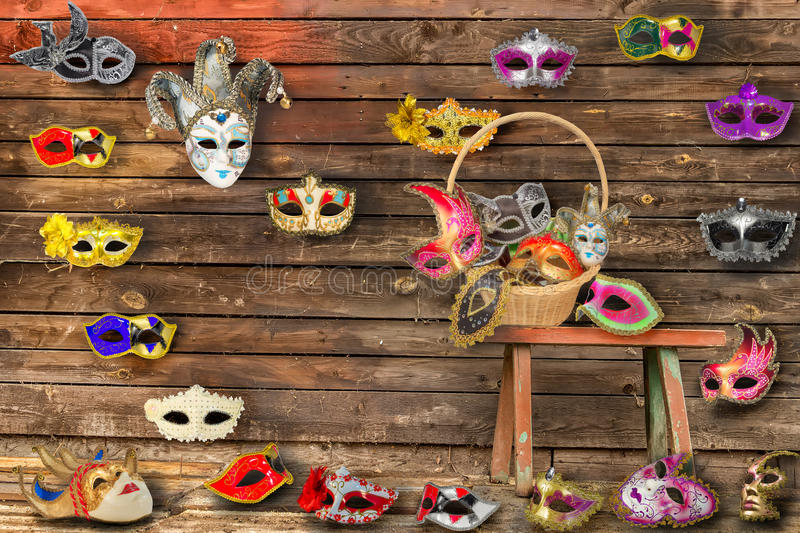 Carnival masks hanging on wall boards lie on floor and bench i royalty free stock image