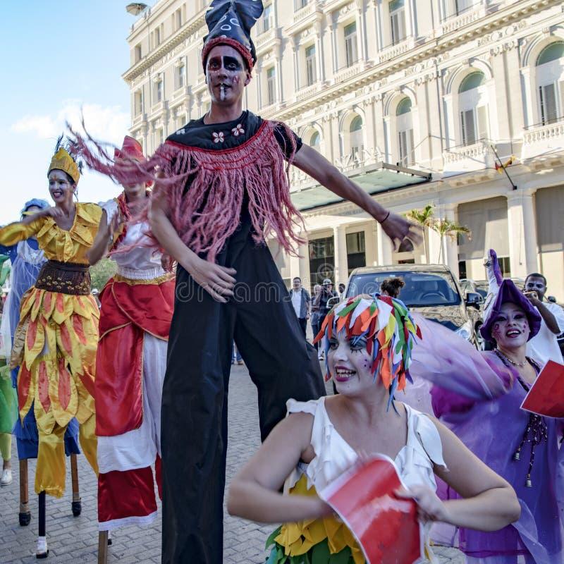 Cuban street performers dancing on stilts, Havana, Cuba stock photos