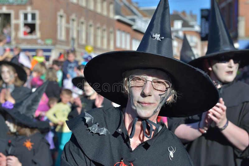 Carnival in Nivelles, Belgium. NIVELLES, BELGIUM-MARCH 03, 2014: Group in costumes of witches participates in defile during yearly carnival in Nivelles royalty free stock photo