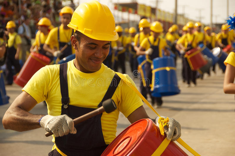 Carnival parade in Barranquilla, Colombia. A man beats a drum during a parade on February 15, 2010 in Barranquilla, Colombia during the yearly carnival stock photo