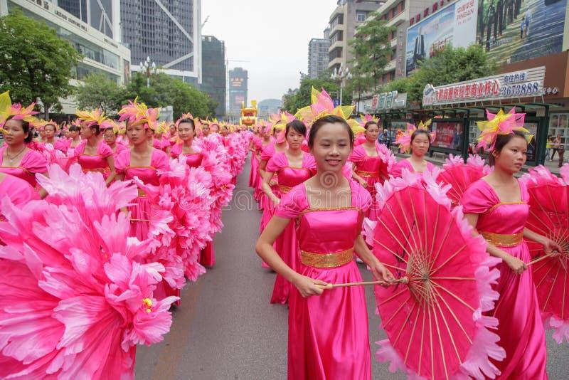 Carnival parade 2013, Liuzhou,China. Liuzhou, China -September 30: Girls wearing red cloth parade during the opening ceremony of 2013 Liuzhou International Water royalty free stock photography