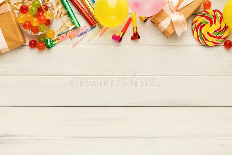 Colorful balloons on white rustic wood, birthday background, top royalty free stock images