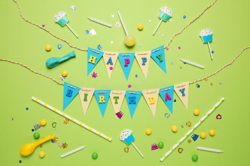 Carnival and party decor. Sweet candy, balloons, straw. Birthday background stock photography
