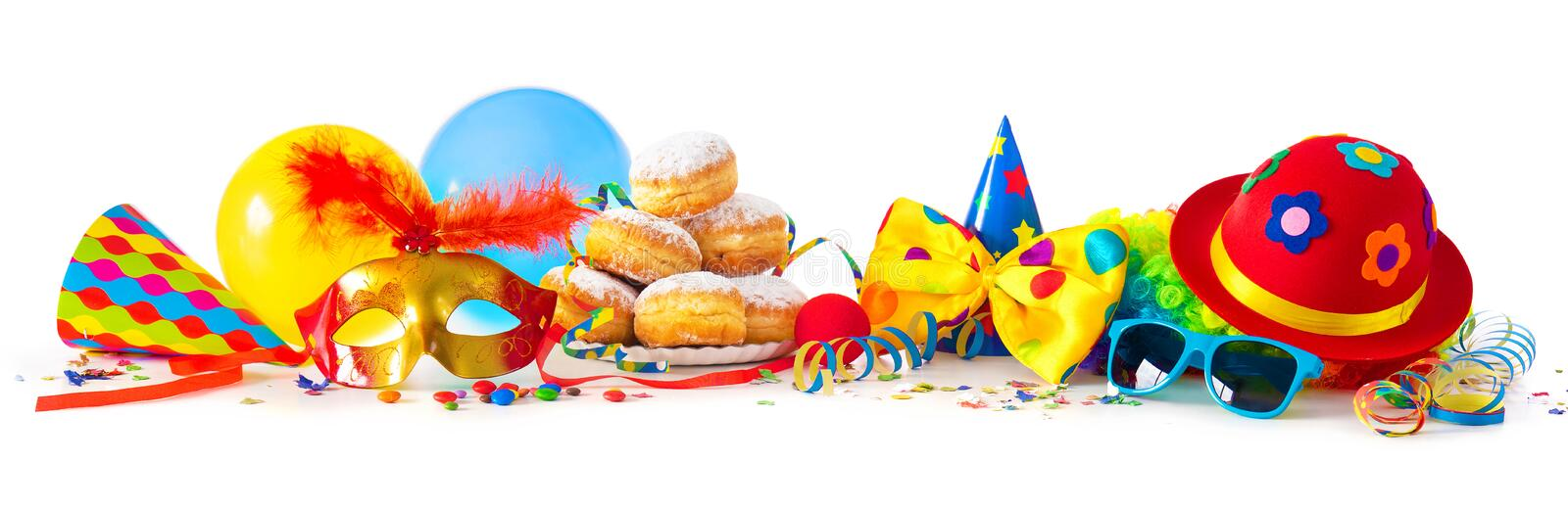 Carnival or party with donuts, balloons, streamers and confetti and funny face royalty free stock image