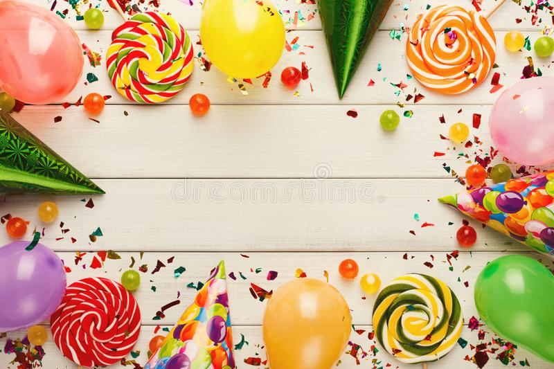 Colorful balloons on white rustic wood, birthday background, top view royalty free stock photos