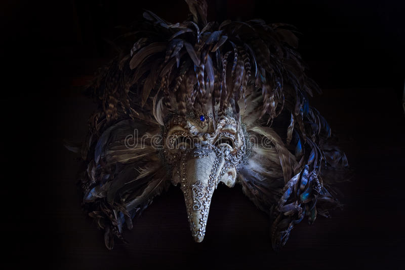 The Carnival Plague Doctor Venetian Mask with colored feathers royalty free stock image