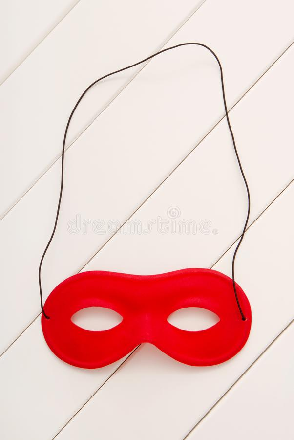 Carnival red mask, mask is on white, theatre accessory royalty free stock image