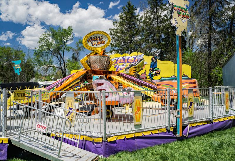 Carnival Ride at the Annual Dogwood Festival. Vinton, VA – April 28th: Carnival ride at the Annual Dogwood Festival located in Vinton, VA on April 28th royalty free stock photography
