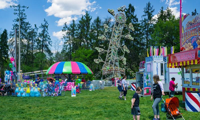 Carnival Rides at the Annual Dogwood Festival. Vinton, VA – April 28th: Families enjoy the carnival rides at the Annual Dogwood Festival located in Vinton stock image