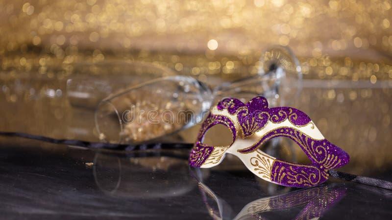 Carnival mask on golden bokeh background, copy space. Carnival time. Venetian mask on golden bokeh background, reflections, copy space royalty free stock photos