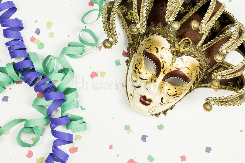 Carnival Venetian mask, confetti and streamers royalty free stock images