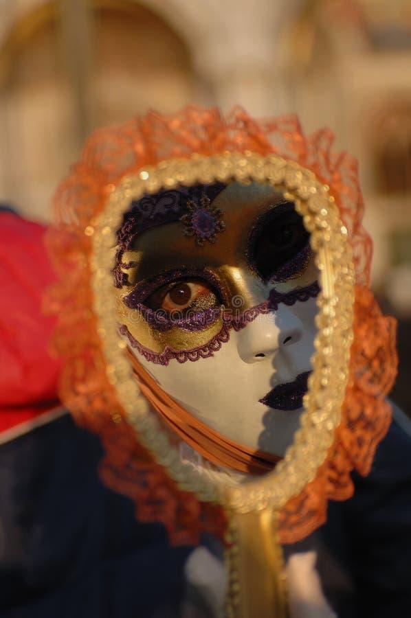 Carnival venice 27. Mask of venice carnival reflected in a mirror stock photo