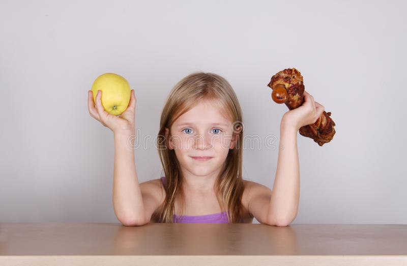 Carnivore keto diet concept - little blond girl eating raw meat. Health food royalty free stock photo
