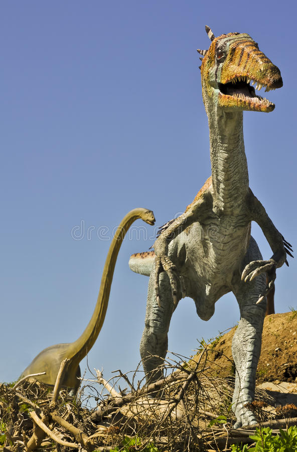 Carnivorous Syntarsus and giant Brontosaurus royalty free stock image